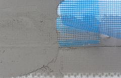 Polystyrene insulation boards covered with mesh covered and mortar Stock Photos