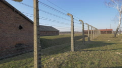 Fence surrounding Auschwitz Extermination Camp Stock Footage