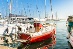 Pleasure boats moored in the harbor. - stock photo