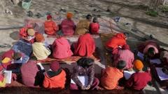 Budhist school children studying outside,Kaza,Spiti,India Stock Footage