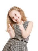 Girl showing sign of ok - stock photo