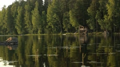 Summer cottage at a calm lake Stock Footage