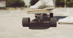 Man standing with one foot on a skateboard Stock Footage