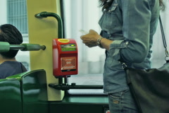 Woman take ticket from the machine, steadycam shot Stock Footage
