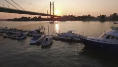 Under the bridge. Boat marinas and river gulls at sunset under the bridge Stock Footage