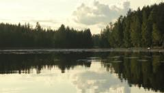 Panning shot at a calm lake in Finland Stock Footage