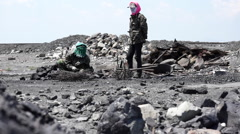 Women extracting coal from mineral residues Stock Footage