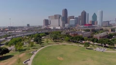 Stock Video Footage of Aerial over Dallas- camera backs up to reveal freeway traffic entering city