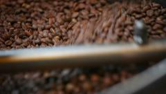 Stirring coffee seeds in roaster Stock Footage