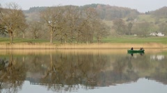 Stock Video Footage of Motor boat sailing on calm waters at Lake Windermere, Cumbria,