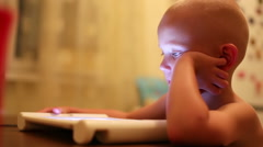 Stock Video Footage of Clever kid watching tablet