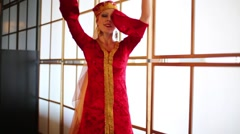 Young woman in red Andalusian costume dances with shawls Stock Footage