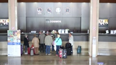 People standing near registration counter in Cosmos hotel Stock Footage