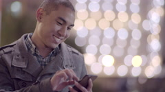 Asian Man Swipes On His Phone, In Downtown San Francisco, Pretty City Lights Stock Footage