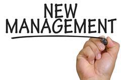 Hand writing new management Stock Photos