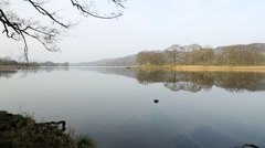 Calm waters of lake Windermere panning left to right Stock Footage