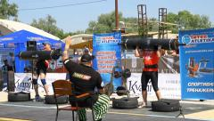 Strongmans competetion in lifting heavy deck Stock Footage
