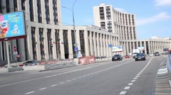 Office building, moving cars at ave. Sakharov. Stock Footage