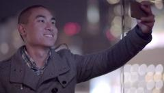 Asian Man Poses For Selfie On A Balcony In Downtown San Francisco (4K) Stock Footage