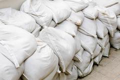 sandbags for flood defense or military use - stock photo