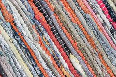 Carpet striped made from little pieces of colorful woven cotton - stock photo