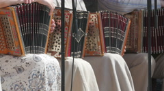 Girls in dress holding their accordions Stock Footage