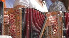 Girls playfully enjoying the accordions Stock Footage