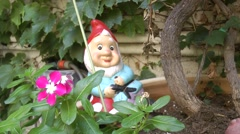Ceramic smiling Dwarf statue Stock Footage