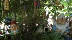 Dwarf statues in garden Stock Footage