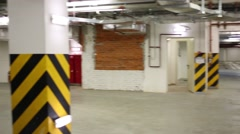 Empty big garage for many cars of residential complex Stock Footage