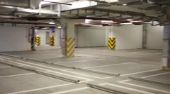 Empty spacious garage for many cars of residential complex Stock Footage