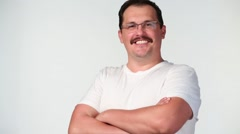 Portrait of confident middle-aged man with mustache in shirt Stock Footage