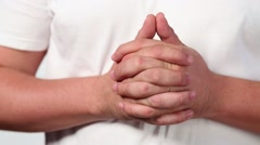 Connected male hands fingering, punch on white t-shirt - stock footage