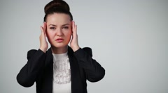 Woman in suit touches forehead and temporal fossa during headache Stock Footage