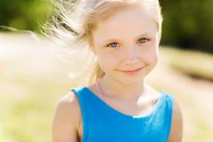 happy little girl outdoors at summer - stock photo