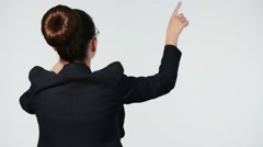 Back of girl with chignon in black suit standing and moving hands Stock Footage