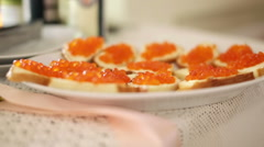 Red caviar sandwiches - stock footage