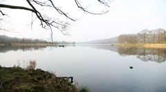 Wide shot of motor boat sailing on calm waters of lake Windermere Stock Footage