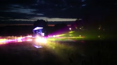 Laser show with many colored rays on pond at nature Stock Footage