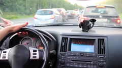 Hand of woman driving car and waiting in traffic jam on highway - stock footage