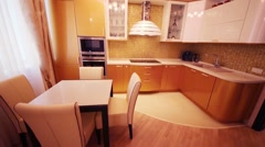 Cozy empty kitchen with gilded shiny furniture and leather chairs Stock Footage