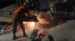 Homeland Security Soldier cuts steel in concrete Stock Footage