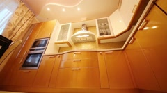 Under view of kitchen with gilded furniture and built-in appliances Stock Footage