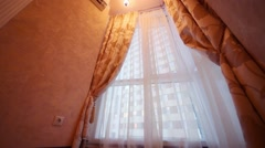 Stock Video Footage of Corner window with beautiful curtains in cozy empty room