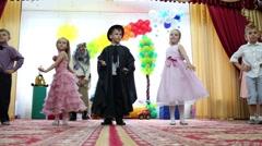 Witch and children dance at children party in kindergarten Stock Footage