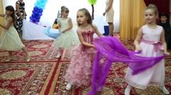 Six girls dance in kindergarten and ten children look at their Stock Footage