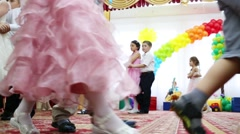 Stock Video Footage of Twenty four boys and girls dance in pairs in kindergarten holiday