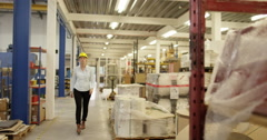 Portrait of a friendly floor manager in a distribution warehouse Stock Footage