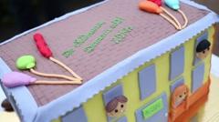 Sweet cake in form of kindergarten outdoor. Stock Footage