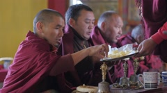 Monk gets breakfast of butter, bread and jam,Kaza,Spiti,India Stock Footage